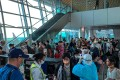 Wuhan residents are screened as they prepare to board their flight home at Kota Kinabalu International Airport in Malaysia on Friday evening. Photo: Handout