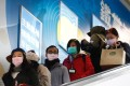 Protective masks on as people use an escalator in Taipei on January 30. Photo: EPA-EFE