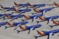 Southwest Airlines Boeing 737 MAX aircraft are parked on the tarmac after being grounded, at the Southern California Logistics Airport in Victorville, on March 28, 2019. Photo: AFP