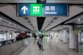 Travellers arrive at Lo Wu MTR station, near the Lo Wu border crossing with the mainland. Photo: Bloomberg