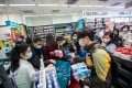 People scramble to buy protective masks at pharmacy in Hong Kong on January 29, amid fears of the Wuhan coronavirus spreading among the local population. Photo: Bloomberg