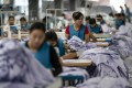China's factory activity cooled slightly in January, with the official purchasing managers' index dropping to 50.0, the National Bureau of Statistics said on Friday. Photo: Xinhua