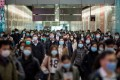 Protective masks all around as commuters walk through Hong Kong Station on January 29. Photo: Bloomberg