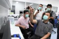 Thai Health Minister Anutin Charnvirakul, right, views closed circuit video images of coronavirus patients at Bamrasnaradura Infectious Disease Institute in Nonthaburi outside Bangkok. Photo: AFP