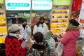 Staff sell masks at a pharmacy in Wuhan, China. Photo: AP