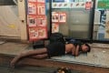 A boy, who lives on the street, sleeps outside a 7-Eleven store in central Bangkok. Many children who run away from home in Thailand end up using and selling drugs or in prostitution. Photo: Tibor Krausz