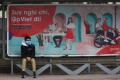 A man wearing a protective facemask sits at a bus stop in Hanoi amid rising concerns over the novel coronavirus outbreak. Photo: AFP