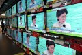 TV screens broadcast Chief Executive Carrie Lam announcing the closure of all but three border crossings with mainland China, in Admiralty on February 3. Photo: Robert Ng