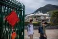 Masks on people walking past a closed Ocean Park, as Hong Kong battles a coronavirus outbreak, on February 3. Photo: Bloomberg