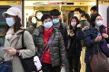 Masked commuters get off a train in Taipei on January 30. Photo: AFP