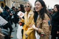 Asian guests attending a recent Paris fashion week show. Concerns over the coronavirus outbreak mean many Chinese fashion industry figures will not attend upcoming fashion weeks in London and Milan, watching and making orders online instead. Photo: Shutterstock
