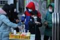 A student sanitises his hands outside Nambu Elementary School in Seoul, South Korea. Photo: EPA