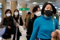 People seen at South Korea's Incheon International Airport in protective face masks on January 3, 2020. File photo: Reuters