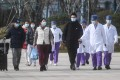Cured coronavirus patients leave hospital in Hangzhou, one of four cities in the eastern Chinese province of Zhejiang which has adopted draconian quarantine measures for its residents. Photo: Xinhua