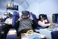 Customers sit in first-class seats and enjoy all the excitement and none of the discomfort of an international flight in Toshima, Tokyo. Photo: AFP