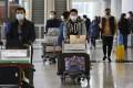 Masked travellers arrive at Hong Kong International Airport. Photo: Jonathan Wong