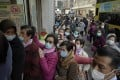 People queue to buy face masks in Hong Kong on January 30, amid uncertainty about both supplies and the government's ability to protect the city against the coronavirus epidemic. Photo: AP