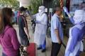 Nurses check the temperatures of visitors as part of the coronavirus screening procedure at a hospital in Kuala Lumpur. Photo: AP