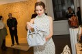 Actress Ali Lee checks out a bag at the Chloé Summer 2020 Cocktail Party. Photos: Handouts