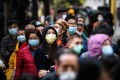 Hongkongers line up to buy face masks. Chinese health authorities on Wednesday reported 3,694 confirmed cases of the coronavirus, down from 3,887 a day earlier. Photo: AFP