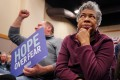 Audience members listen at a Democratic caucus rally in Iowa. Photo: Reuters