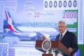 Mexico's President Andres Manuel Lopez Obrador stands in front of an image of a raffle ticket featuring the presidential plane at the National Palace in Mexico City on Friday. Photo: Mexico's Presidential Press Office via AP