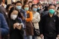 People line up to buy face masks outside a pharmacy in Hong Kong. Photo: EPA-EFE
