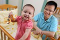 Full-time dad Terry Chan Wai-nok and his one-year-old daughter Chan Tin-ching at home in Tai Wo Estate, Tai Wo.