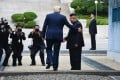 US President Donald Trump meets Kim Jong-un in the demilitarised zone between the two Koreas. Photo: AFP