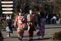 Tourists wearing masks visit the Sensoji temple in Tokyo, on January 30. Japan's Prime Minister Shinzo Abe has said the Tokyo Olympic Games will go ahead despite novel coronavirus fears. Photo: EPA-EFE