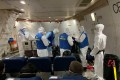 Staff from the US embassy board a cargo plane, chartered by the US State Department to evacuate Americans and Canadians from China due to the outbreak of novel Coronavirus, during the boarding process at Wuhan Tianhe International Airport in Wuhan on February 7, 2020. Photo: Reuters