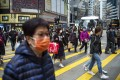 Pedestrians wearing protective masks in Causeway Bay. Hong Kong reported a death from the coronavirus and 42 infections as of Tuesday. Photo: Warton Li
