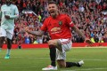 Manchester United 1999 Legends player David Beckham celebrates scoring during the Treble Reunion 20th anniversary match against FC Bayern Legends at Old Trafford. Photo: AFP