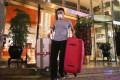 A tourist checks out from a hotel in Tsim Sha Tsui. Photo: Sam Tsang