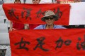 China women's football team fans cheer with banners supporting their team and Wuhan city in the Olympic qualification tournament in Sydney. Photo: Xinhua