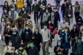 Commuters wearing protective masks walk through Hong Kong Station on Tuesday. Photo: Bloomberg