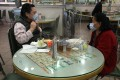 A perspex wall divides two diners who know each other at a cha chaan teng in Tai Kok Tsui in Kowloon. Photo: Nora Tam