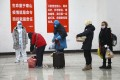 Patients diagnosed with the coronavirus arrive at a temporary hospital in Wuhan. Photo: AP