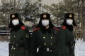 Chinese paramilitary police officers wearing face masks stand outside the headquarters of the People's Bank of China in Beijing on February 7. While some analysts have said China's economy could be adversely affected by the coronavirus, the Chinese central bank has already injected a large amount of liquidity into the system. Photo: EPA-EFE