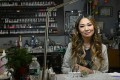 """Nail artist Jenny Bui, also known as the """"Queen of Bling"""", at her nail salon in the Bronx, New York. Photo: AFP"""
