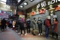 Shoppers queue for surgical masks outside of a shop in Causeway Bay. Photo: Xiaomei Chen