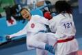 Hong Kong's Jennifer Tsang (left) lands a blow on Dilnoza Bakirova of Uzbekistan during the kumite women's 50kg final at Gyeyang Gymnasium in Incheon, South Korea.