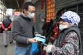 Benson Tsang hands out donated masks to those in need in Sham Shui Po. Photo: Xiaomei Chen