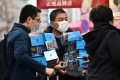 Customers buy face masks in Tokyo's Akihabara area on January 27. Photo: Charly Triballeau/AFP