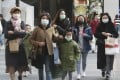 People seen in face masks at a shopping district in Taipei. File photo: AP