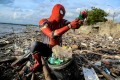 Rudi Hartono dons a Spider-Man costume as he collects plastic waste and other rubbish at a beach in Pare-Pare, South Sulawesi province, Indonesia, in January. Photo: Reuters