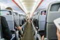 A modern aircraft cabin, in which the air is changed every two to three minutes, much more often than in an office, cinema, or classroom on the ground. To minimise the risk of catching a respiratory illness from a fellow passenger, choose a window seat, experts say. Photo: Getty Images/iStockphoto