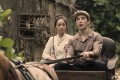 Peijia Huang (left) as Pan Li Lan and Ludi Lin as Lim Tian Bai in a still from The Ghost Bride, a Taiwanese-Malaysian thriller now streaming on Netflix. Photo: Netflix