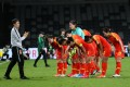 China players bow to their coach Jia Xiuquan after their 1-1 draw with Australia in an Olympic qualifier in Sydney. Photo: Xinhua