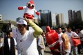 A man holds a condom puppet during an event in Mexico City. Photo: Reuters
